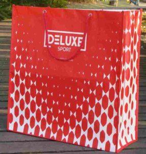 Importaciones de China de bolsas de tejido no tejido con costura y asa de anilla
